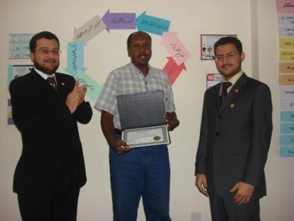 Trainee Awadalla Babker is receiving his certificate