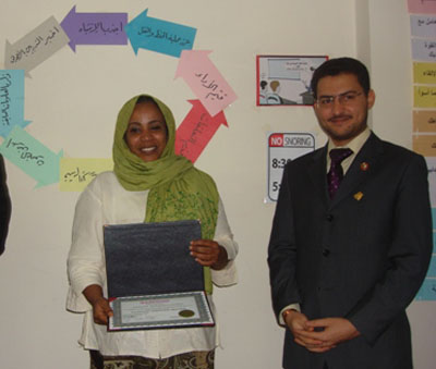 Trainee Entisar Elyas while receiving the certificate