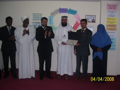 The trainer Salem Alsaadi while distributing certificates
