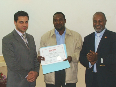 Trainee Abdelqader Baraq is receiving his certificate