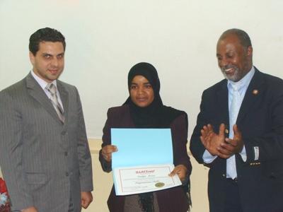 Trainee Najat Azizy is receiving her certificate
