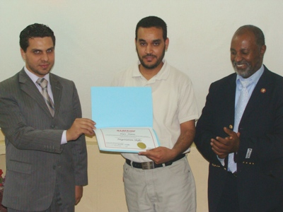 Trainer Alyias Ameeny is receiving his certificate from the trainer Basel Alnassar with the attendance of the Franchise manager