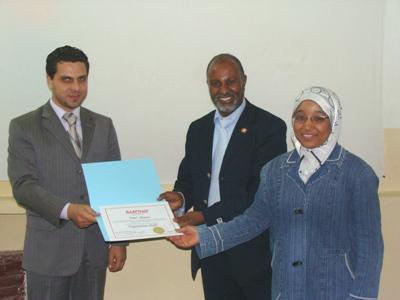 Trainee Amaal Slaimany, trainer Basel Alnassar, and Mr. Altaiyyb Beleek
