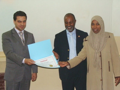 Trainee Samia Ibn Zughayer is receiving her certificate