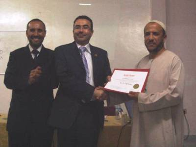 Trainer Ahmad Naser Alkhateeb, trainee Hassan Hamouch, and trainee Ibrahim Talioua while distributing the certificates