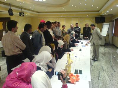 Trainer Mohammad Pedra is displaying the learning and the training methods at the conference of the end of the workshop