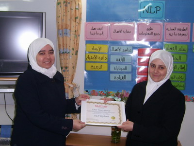 Trainee Eeman Daoud is receiving her certificate