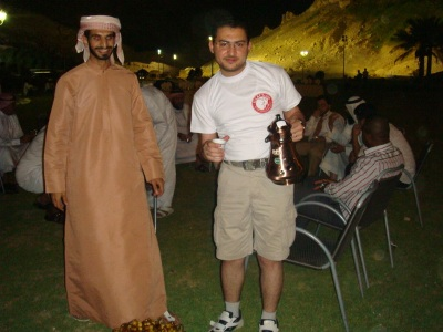 Trainer Tony Peter is offering coffee in the Emiratis way by the guidance of trainee Mahmud Alalwai