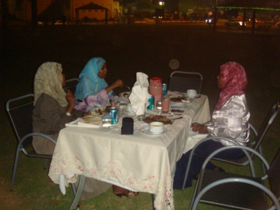 The female trainees and the training manager during the dinner