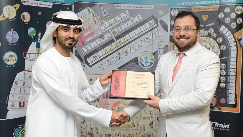 الدكتور محمد يسلم المدرب ماجد شهادة شكر